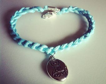 Turquoise cord with a charm bracelet