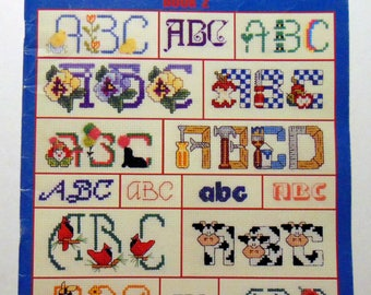 """Counted Cross Stitch """"120 Alphabets"""" Easter COws Cardinal Clown 4th of July 1994"""
