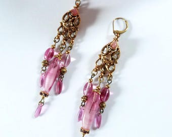 Indian romantic earrings in gold and pink rhinestone and beads.