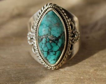 Worked with silver and turquoise stone ring