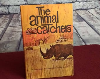 """Subtitle: """"A violent novel about people and animals in Africa..."""" The Animal Catchers by Colin Willock -- beautiful cover art"""