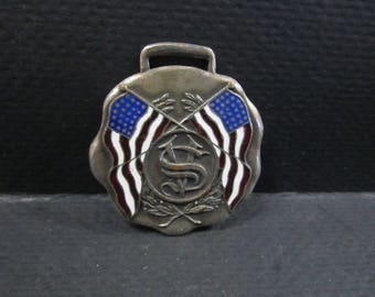 vintage watch fob with two American flags