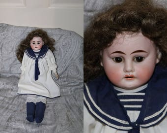 Antique Bisque Doll - Made in Germany - Kid Leather Body - Brown Glass Eyes - Bisque Hands - Arms Replaced with Cloth