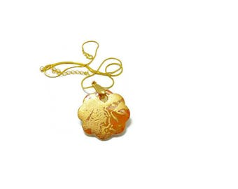 jewel in gold and orange porcelain