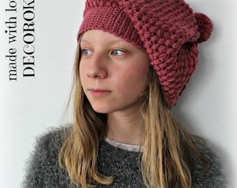 Bonnet rose tombant fait main au crochet.