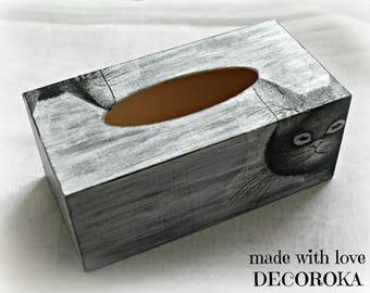 Box has tissue distressed cat