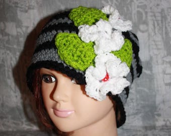 black and grey hat with white flowers and leaves