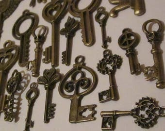 26 charms key charms. bronze color.