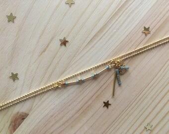 Lovely night - Bracelet double chaîne boule et breloques dorées