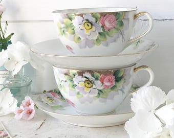 A beautiful antique handpainted tea cup and saucer