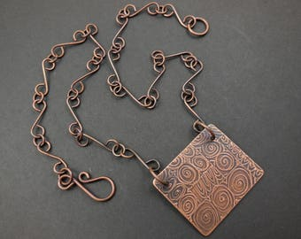 Copper etched metalwork pendant with copper link chain