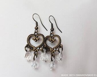 SWAROVSKI Crystal white drop earrings / bronze