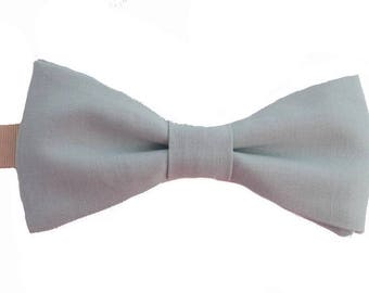 Green bowtie with water to straight edges