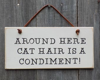 Around Here Cat Hair Is A Condiment, funny cat saying, wooden hanging sign, cat home decor. 4 inches by 8 inches B