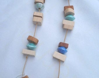 handcrafted wooden jewelry and turquoise ceramic