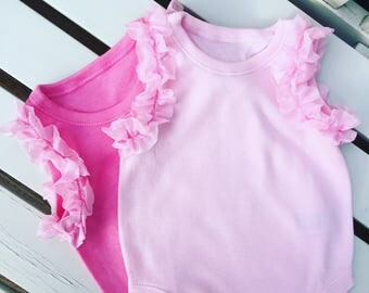 Pink lace trimmed baby girl bodysuit vest in sizes 3-6 months, 6-9 months, 9-12 months with frilly pink lace ruffle and sparkle!