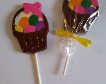 Easter basket filled with eggs chocolate lollipop