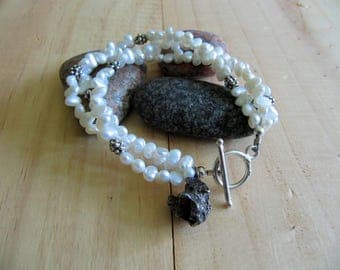 Unique pearls bracelet with a real meteorite pendant