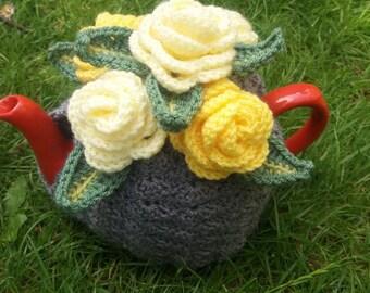 Six tea cosies
