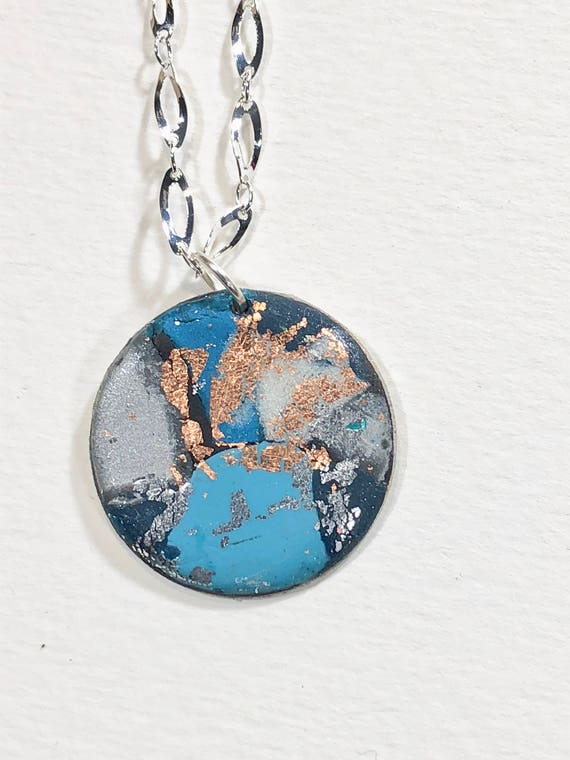 Handmade turquoise/blue/white/silver/copper polymer clay round pendant necklace with abstract asymmetric design