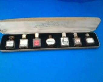 Vintage boxed set of 7 micro mini perfume bottles khus Khus, Bat Sheba, Chanel no 5, Indiscreet, Cabouchard, Carnet de Bal, Miss de Rauch
