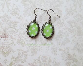 Green star earrings white
