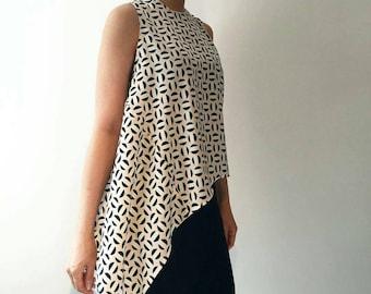Geometric circle printed asymmetric sleeveless top
