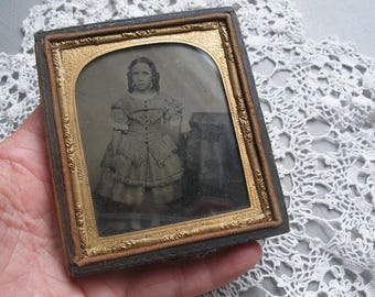 Ambrotype of little girl in checked dress, mid 19th century