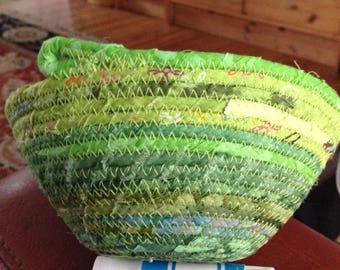 Small round green coiled clothesline ring catcher basket