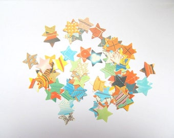 Vintage paper stars: pack of 100 hand punched from vintage 1960s books. Embellishments for paper craft, scrapbook, cards, wedding. PE394