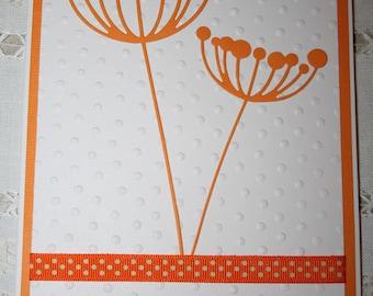orange and white coloured card