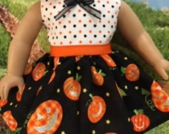 """Halloween doll dress with sparkle accents on the pumpkin faces. Fits most 18"""" dolls."""