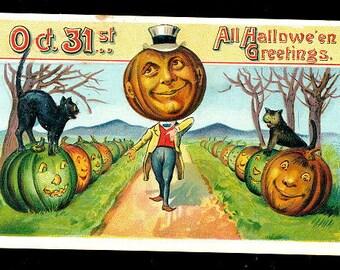 1909 Halloween JOL Head with Black Cat Postcard