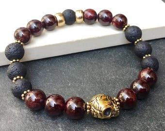 Garnet and lava beads bracelet - Stretch bracelet - Skull bracelet - Mala bracelet - Boho chic gypsy bracelet - Stackable bracelet -