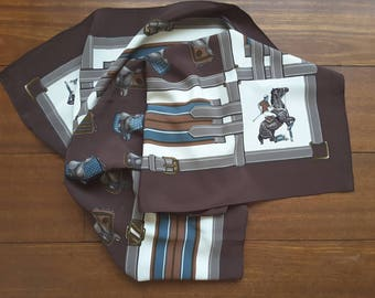 Scarf with horses, equestrian, horse theme saddles. In soft colours.