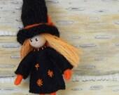 small orange witch bendy doll
