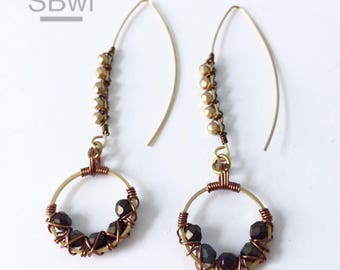 Geometric earrings in bronze with black and metallic detail