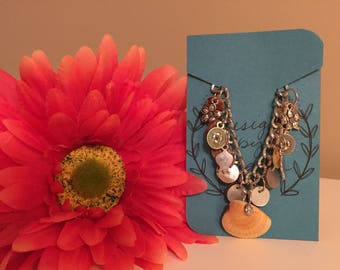 Charlotte - Seashells and silver plated charms and chain bracelet