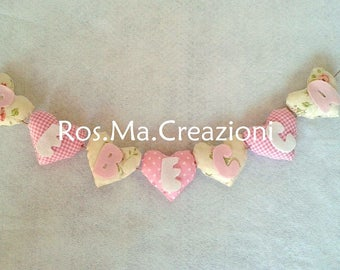 Formanome hearts customizable banner with the name of your child.