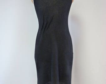 The hot price. Amazing elegant black linen dress with v-neck on the back.