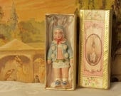 12th scale model of a dolls house toy doll in presentation box