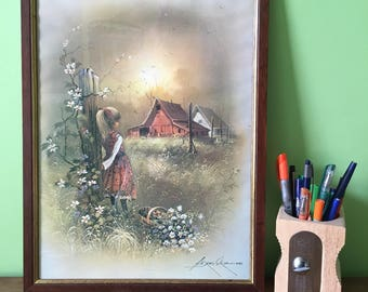 Framed Print by Andres Orpinas. Girl and the Farmhouse. Kitsch Big Eye Children. Naive Folk Art. Country Art. Chile.