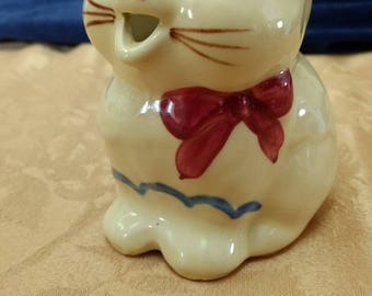 1940's Patented Puss and Boots pitcher
