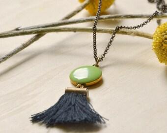 Long necklace Art Deco green resin anise, black tassel and brass bronze
