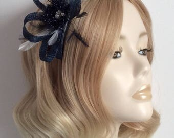 NAVY and WHITE FASCINATOR,  Made with sinamay, feathers, Polka dot chiffon flower, on  a black comb