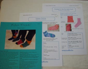 3 sock knitting patterns, 3 for adults and one for child.  Each Pattern is new.
