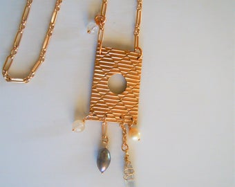 Handmade necklace with ornate gilt bronze rectangle pendant with freshwater pearls, quartz, plated brass, Haiku collection chain.