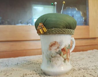 Victorian Pincushion. Made with a Hand Painted Porcelain Cup and Vintage Bling.