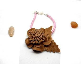 Pink leather and beige flower bracelet