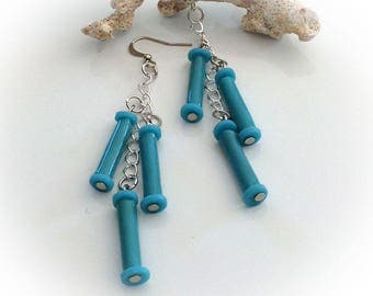 Earrings, turquoise blue polymer tube beads.